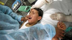 Algerian boy being held down in Kouba Hospital in Algiers as he's circumcised