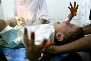 Boy being mutilated