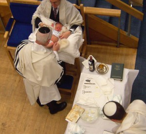 Rabbis about to circumcise infant