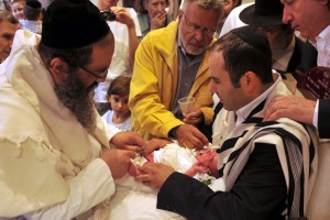 Jews perform a brit mila in the French Jewish Community in Paris, France The Brit Milah is a religious ceremony within Judaism to welcome infant Jewish boys into a covenant between God and the Children of Israel through ritual circumcision performed by a mohel (circumciser), the ceremony takes place on the eighth day of the child's life. Photo by Serge Attal